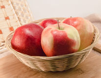 Apples in a wicker basket Stock Photo