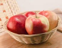 Apples in a wicker basket Stock Photo