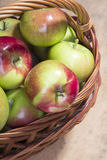 Apples in a wicker basket. Tasty organic apples in a wicker basket Stock Image