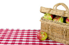 Apples in wicker picnic basket Stock Image