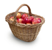 Apples in wicker with precise clipping path. Fresh apples in wicker basket isolated on white with precise clipping path Royalty Free Stock Images