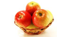 Apples in a wicker vase Stock Image