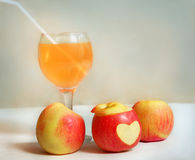 Apples with wine glass of apple juice on the table Royalty Free Stock Photos
