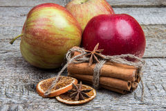 Apples and winter spices on wooden background. Christmas set Royalty Free Stock Image