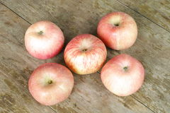 Apples on the wood background Stock Photos