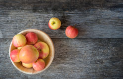 Apples in a wood bowl on wooden background. Royalty Free Stock Photo