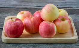 Apples in a wood bowl on wooden background. Royalty Free Stock Image