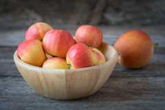 Apples in a wood bowl on wooden background. Stock Photo