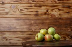 Studio shot of apples on wooden background. Studio shot of green apples on wood on wooden background royalty free stock photos