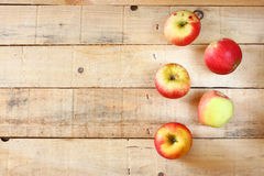 Apples on wooden background with glitter lights Stock Photography