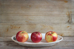 Apples on wooden background Stock Image
