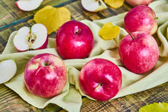 Apples on a wooden background. Red apples. Colorful photo. Fruit Royalty Free Stock Images