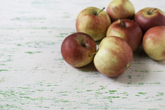 Apples on wooden background. Some apples lie on a wooden background Royalty Free Stock Photography