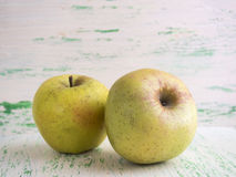 Apples on wooden background. Some apples lie on a wooden background Stock Photo