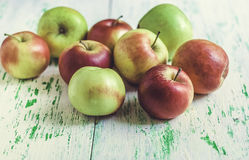 Apples on wooden background. Some apples lying on a wooden background Stock Photography