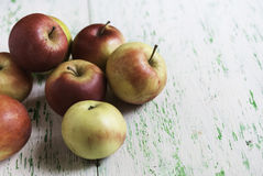 Apples on wooden background. Some apples lying on a wooden background Royalty Free Stock Photos