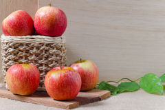 Apples on wooden background stock photography