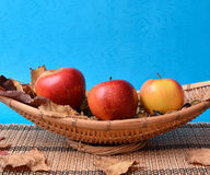 Apples on wooden bamboo fruits plate Royalty Free Stock Photo