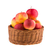 Apples in a wooden basket isolated on white background. Vegetarian. Royalty Free Stock Photography