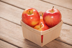 Apples in a wooden basket Stock Images