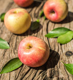 Apples on a wooden board Royalty Free Stock Images
