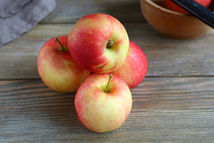 Apples on wooden boards Royalty Free Stock Photo