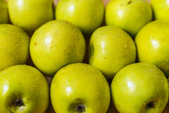 Apples on wooden boards Royalty Free Stock Images