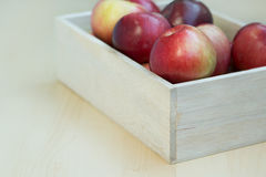 Apples in the wooden box on the table Royalty Free Stock Photo