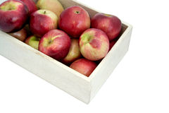 Apples in the wooden box on the table, close up. Food market Royalty Free Stock Photography