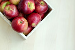 Apples in the wooden box on the table, close up. Food market Royalty Free Stock Images