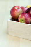 Apples in the wooden box on the table, close up Royalty Free Stock Photography
