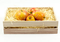 Apples in wooden crate. On straws royalty free stock photography