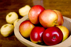 Apples in wooden pan Stock Photos