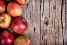Apples on wooden plank Royalty Free Stock Images