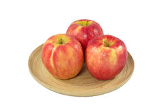 Apples in wooden plate on a white background Royalty Free Stock Photos