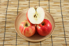 Apples in wooden plates Royalty Free Stock Photography