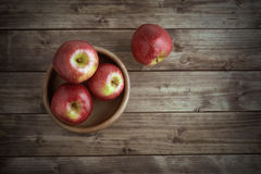 Apples in a wooden saucer Stock Photos