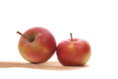 Apples on a wooden spoon Royalty Free Stock Images