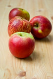 Apples on wooden table Stock Images