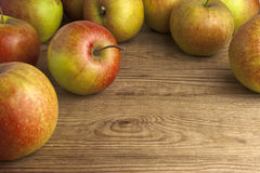 Apples on wooden table Royalty Free Stock Image