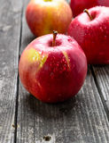 Apples on wooden table Stock Photos