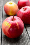 Apples on wooden table Royalty Free Stock Photography