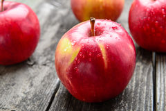 Apples on wooden table Stock Image