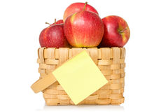 Apples in woven basket with sticky note Stock Photos
