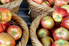 Apples in Woven Baskets Royalty Free Stock Photos