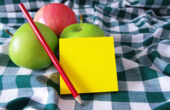 Apples and yellow note pad Royalty Free Stock Photo