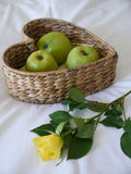 Apples & a yellow rose Royalty Free Stock Photography