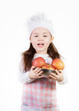 Apples. A young girl uses fresh apples to make something good to eat royalty free stock photo