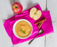 Applesauce on pink paper and spoon Stock Images