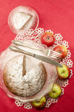 Applesauce raisin rum cake for christmas table. Table decorated with lacy napkin. From series of Merry Christmas Royalty Free Stock Photography